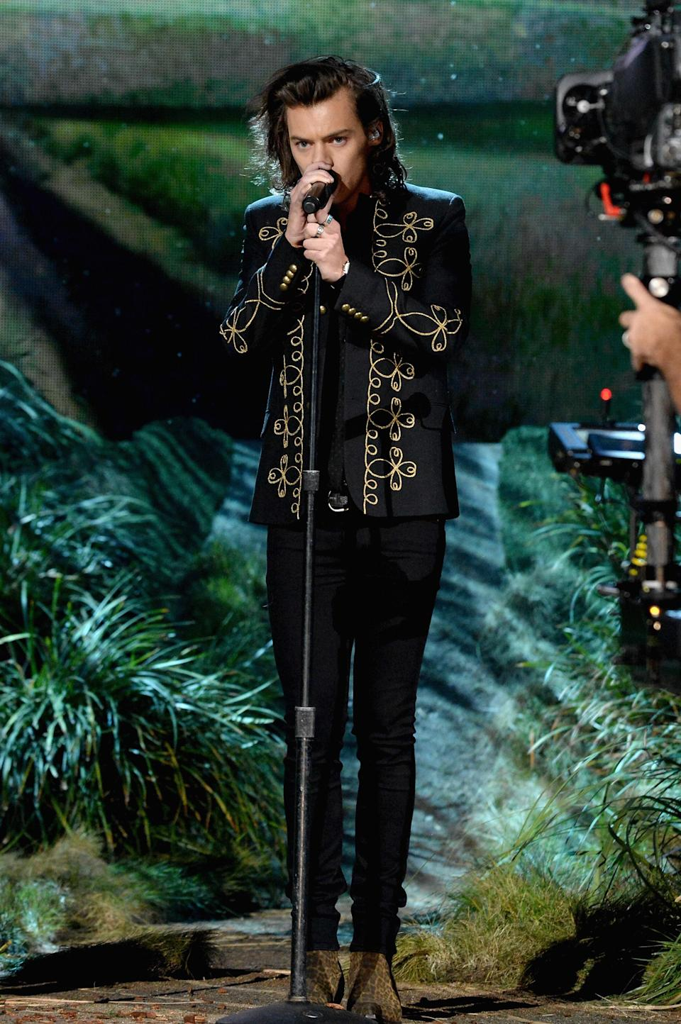 His vintage band jacket and leopard boots were a <em>major</em> highlight of the 2014 AMAs.
