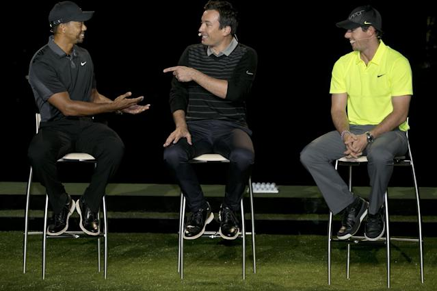 Golfer Rory McIlroy, right, listens as fellow golfer Tiger Woods, left, banters with television host Jimmy Fallon during a golfing demonstration, Monday, Aug. 18, 2014, in Jersey City, N.J. (AP Photo/Mel Evans)