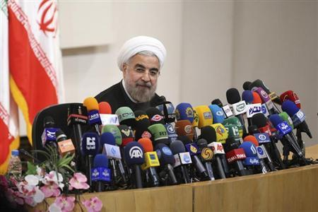 Iranian President-elect Hassan Rohani speaks with the media during a news conference in Tehran