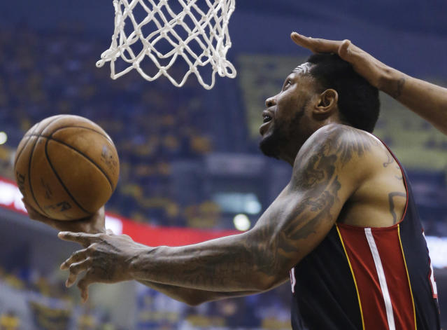 Miami Heat forward Udonis Haslem shoots against the Indiana Pacers during the first half of Game 5 of the NBA basketball Eastern Conference finals in Indianapolis, Wednesday, May 28, 2014. (AP Photo/Michael Conroy)