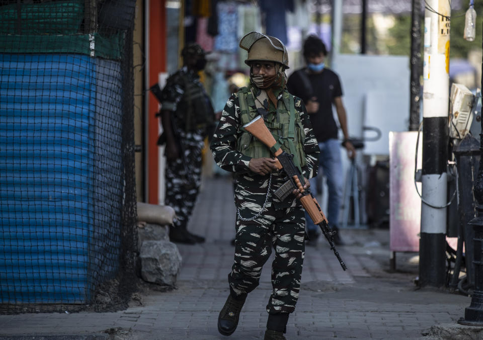 An Indian paramilitary soldiers patrol a street in Srinagar, Indian controlled Kashmir, Tuesday, Aug. 24, 2021. Indian government forces killed two senior rebel commanders and three other militants in two separate counterinsurgency operations in disputed Kashmir, police said Tuesday. (AP Photo/Mukhtar Khan)