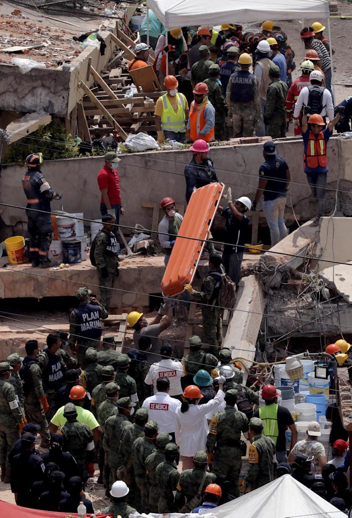 <p>Rescuers and members of Mexican Army search for survivors at the Enrique Rebsamen school after an earthquake in Mexico City, capital of Mexico, on Sept. 20, 2017. (Photo: Montse Lopez Flores/Xinhua via ZUMA Wire) </p>