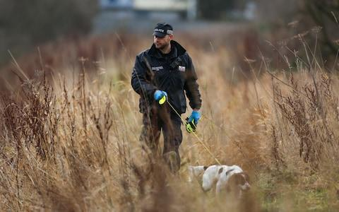 Police dog teams search the river bank behind Wellesley Avenue, Hull - Credit: SWNS