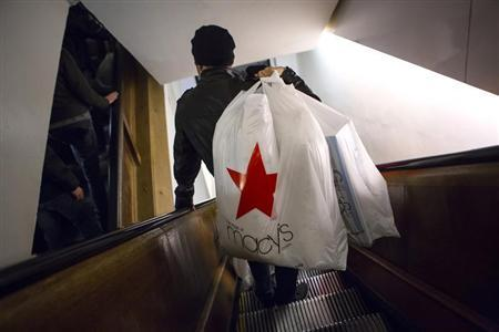 Shoppers ride the escalator at Macy's Herald Square in New York in this November 28, 2013 file photo. U.S. consumers shopped less on the final weekend before Christmas despite deeper discounts, the latest sign of how difficult a season this is turning out to be for retailers. Picture taken November 28, 2013. REUTERS/Eric Thayer