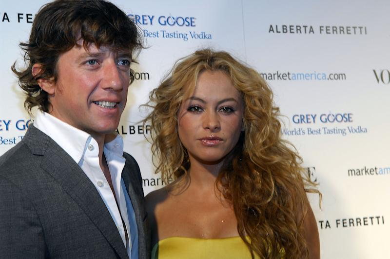 "MIAMI BEACH, FL - DECEMBER 08: Singer Paulina Rubio (R) and husband Nicolas ""Colate"" Vallejo Najera poses at the Market America and Vogue party hosted by Loren Ridinger on December 08, 2007 in Miami Beach, Florida (Photo by Gustavo Caballero/Getty Images)"
