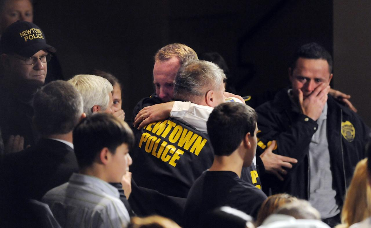 NEWTOWN, CT - DECEMBER 16:  Newtown first responders received an emotional standing ovation as they entered the auditorium for a vigil at Newtown High School on December 16, 2012 at Newtown High School in Newtown, Connecticut. Twenty-six people were shot dead, including twenty children, after a gunman identified as Adam Lanza opened fire at Sandy Hook Elementary School. Lanza also reportedly had committed suicide at the scene. A 28th person, believed to be Nancy Lanza, found dead in a house in town, was also believed to have been shot by Adam Lanza. (Photo by Stephen Dunn-Pool/Getty Images)
