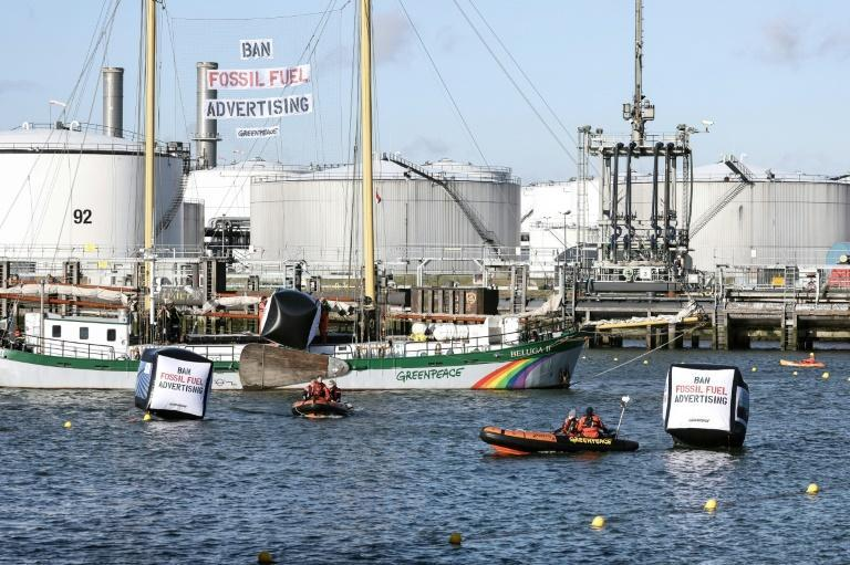 Greenpeace campaigners used a sailing ship, kayaks and rubber dinghies to obstruct the entrance to the Shell oil refinery (AFP/Kenzo TRIBOUILLARD)