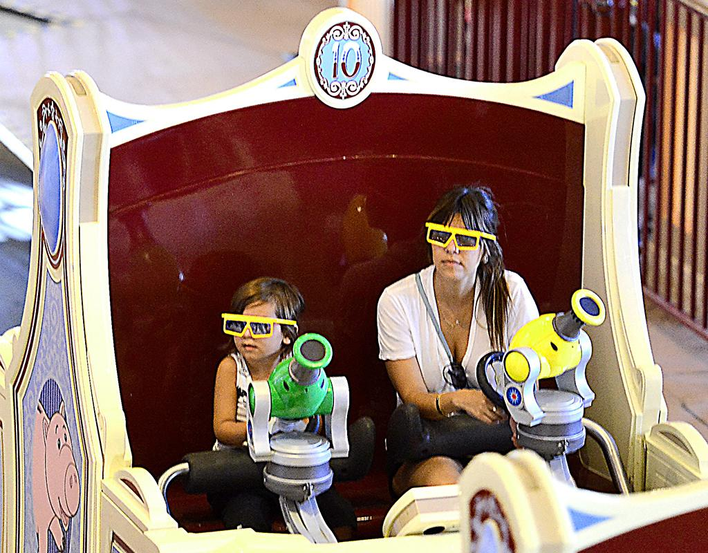 Kourtney Kardshian and son Mason Disick, 3, donned 3D glasses on the fun Toy Story Mania ride at Disney's California Adventure outside L.A. Wonder who won … (5/22/2013)