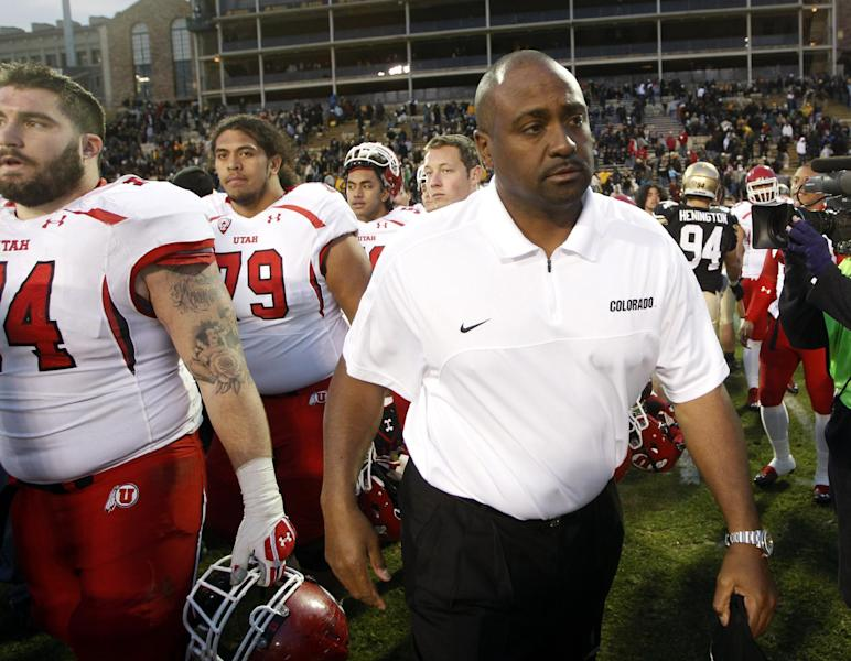 Colorado head coach Jon Embree, center, leaves the field after Utah's 42-35 victory over Colorado in an NCAA college football game in Boulder, Colo., on Friday, Nov. 23, 2012. (AP Photo/David Zalubowski)