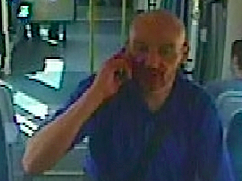 Police have released CCTV pictures in the hunt for a drunk man who attacked a pregnant woman on a tram. (SWNS)