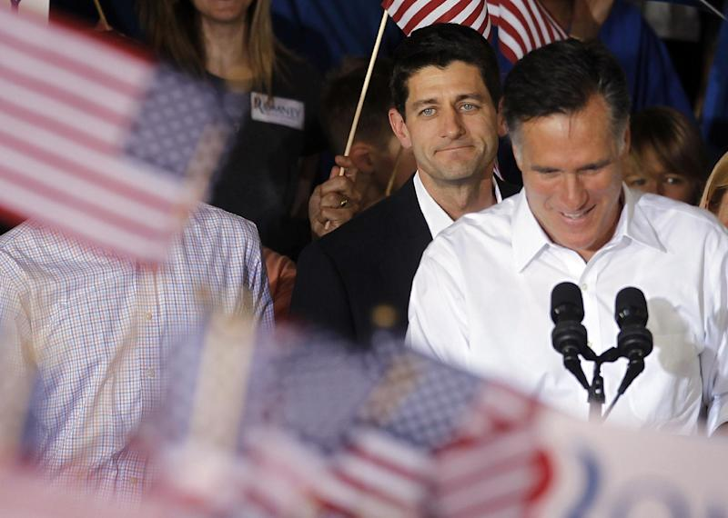 Republican presidential candidate, former Massachusetts Gov. Mitt Romney, right, with his newly announced vice presidential running mate, Rep. Paul Ryan, R-Wis., standing behind him, during a campaign rally in Manassas, Va., Saturday, Aug. 11, 2012. (AP Photo/Pablo Martinez Monsivais)