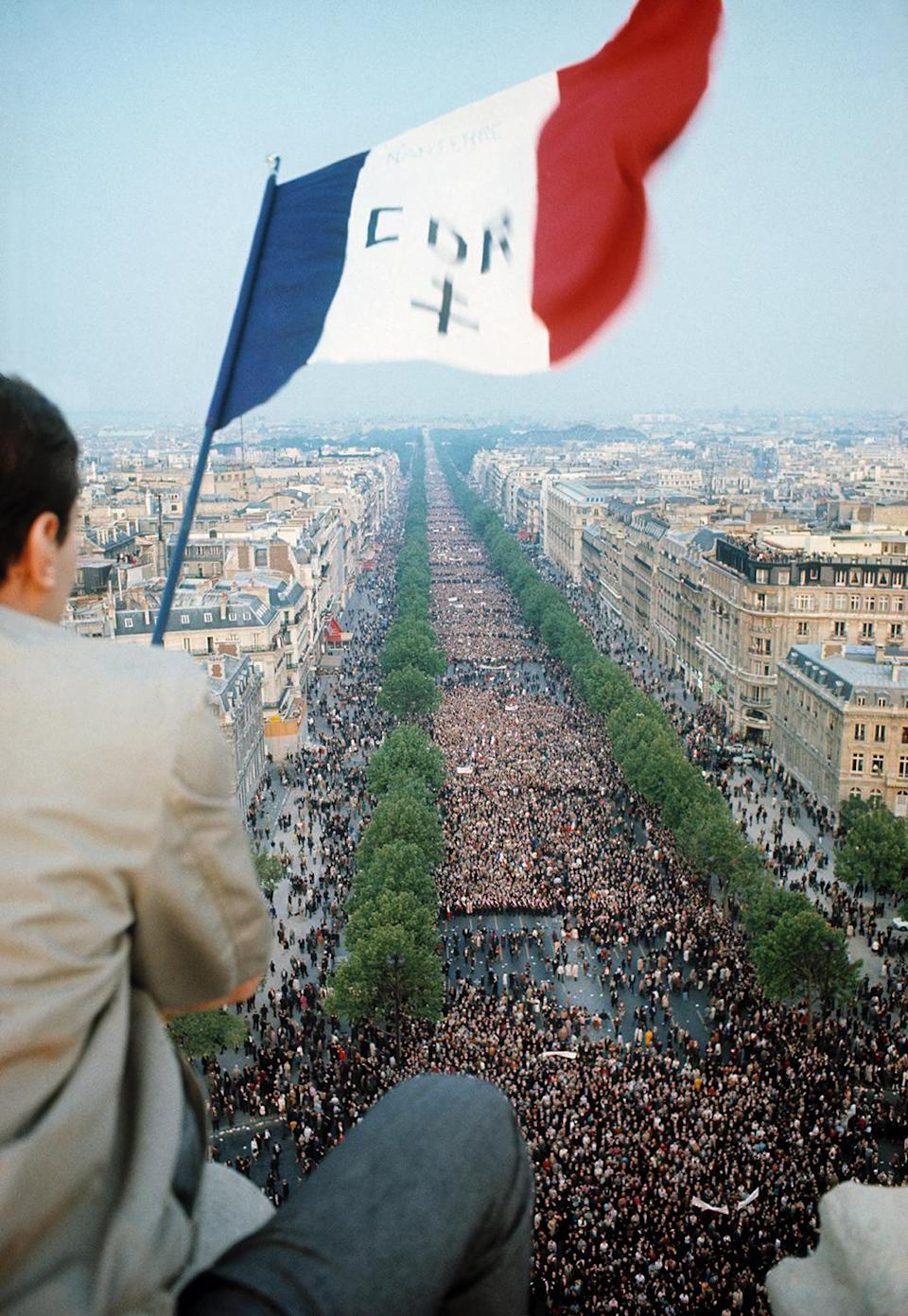 <p>More than a half-million people march up the Avenue des Champs-Élysées to support President Charles de Gaulle after he announced the dissolution of the National Assembly, postponement of the referendum, a change in the government under Prime Minister Georges Pompidou, and a call to civic action in the face of student and worker unrest, Place de l'Étoile, Paris, May 30, 1968. (Photo: Gökşin Sipahioğlu/SIPA) </p>