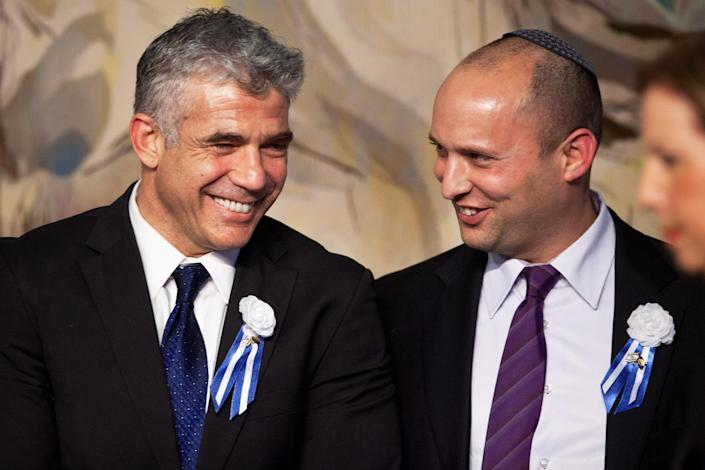 Image: Yair Lapid and Naftali Bennett (Uriel Sinai / Getty Images file)