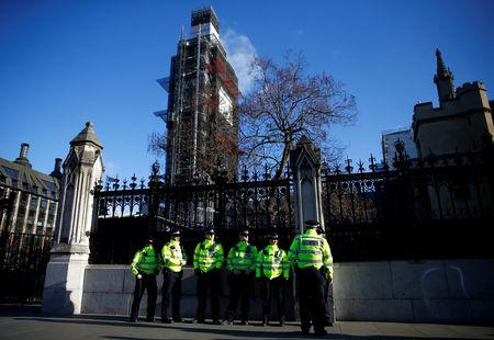 Police officers are seen in front of the gate of the Houses of Parliament, in London, Britain, January 8, 2019. REUTERS/Henry Nicholls