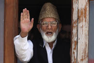 CORRECTS AGE - FILE - In this Wednesday, Sept. 8, 2010, file photo, Kashmiri separatist leader Syed Ali Shah Geelani waves to the media before his arrest in Srinagar, India. Geelani, an icon of disputed Kashmir's resistance against Indian rule and a top separatist leader who became the emblem of the region's defiance against New Delhi, died late Wednesday, Sept, 1, 2021. He was 91. (AP Photo/Altaf Qadri, File)