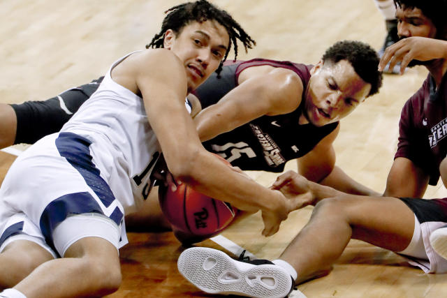 Pittsburgh's Kene Chukwuka, left, and Pittsburgh's Kene Chukwukacneter fight for a loose ball beside AJ Cheeseman during the second half of an NCAA college basketball game, Saturday, Dec. 15, 2018, in Pittsburgh. Pittsburgh won 78-43. (AP Photo/Keith Srakocic)