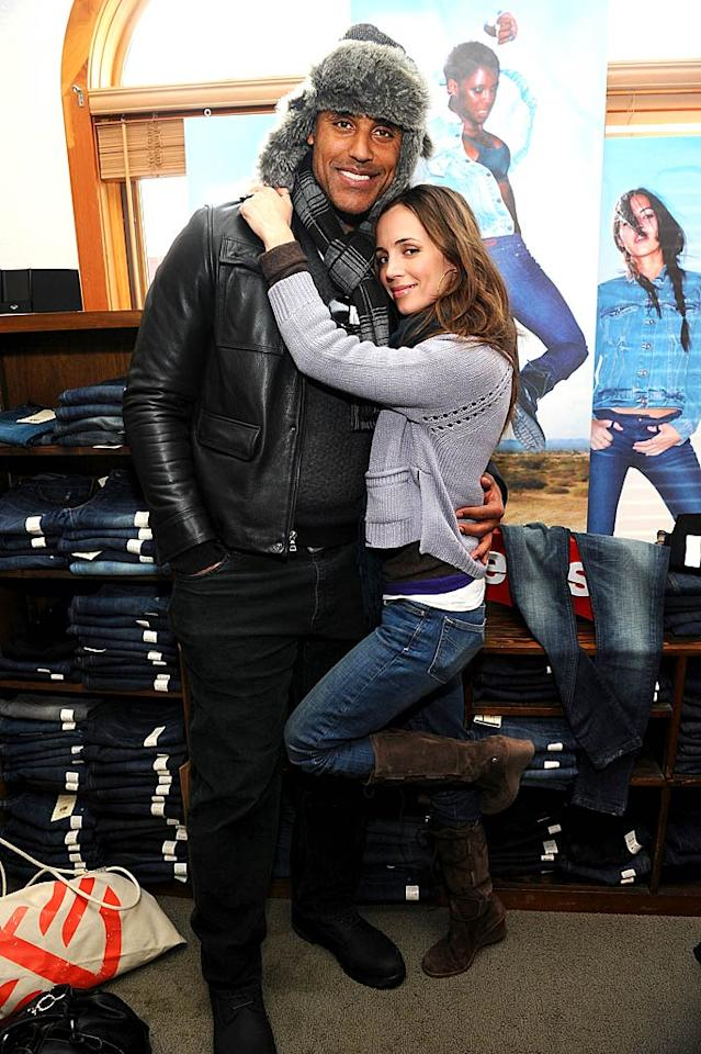 "Eliza Dushku got a leg up on her boyfriend Rick Fox and at the Levi's AE Showroom. Nice hat Rick! Jamie McCarthy/<a href=""http://www.wireimage.com"" target=""new"">WireImage.com</a> - January 22, 2011"