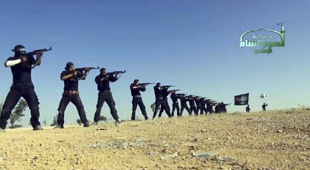An image grab taken from a propaganda video in 2013 by Syria's Islamist Ahrar al-Sham group shows its members taking part in a training session at an undisclosed location in Syria (AFP Photo/)