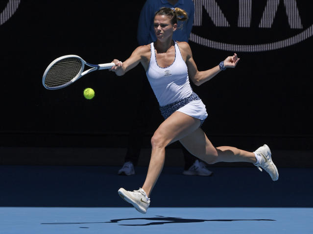 Italy's Camila Giorgi makes a forehand return to Germany's Angelique Kerber during their third round singles match at the Australian Open tennis championship in Melbourne, Australia, Saturday, Jan. 25, 2020. (AP Photo/Andy Brownbill)