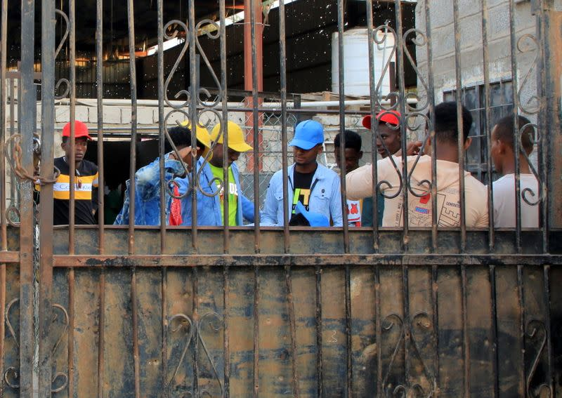 Ethiopian migrants prepare to leave an IOM shelter before they were flown back to Ethiopia, in Aden