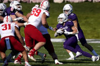 Northwestern running back Drake Anderson, second from right, runs with the ball during the first half of an NCAA college football game against Nebraska in Evanston, Ill., Saturday, Nov. 7, 2020. (AP Photo/Nam Y. Huh)