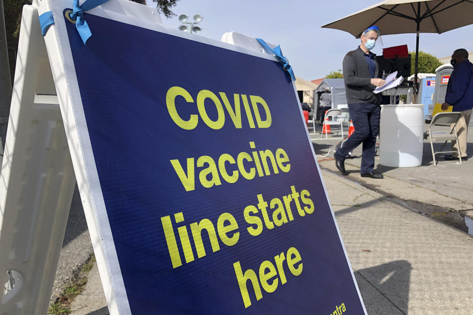 FILE - In this Feb. 8, 2021 file photo a sign is displayed at a COVID-19 vaccine site in the Bayview neighborhood of San Francisco. San Francisco city workers will be required to be vaccinated against the coronavirus when a vaccine receives full federal approval. The policy covering 35,000 municipal workers may be the first by any city or county in the U.S., the San Francisco Chronicle reported Wednesday, June 23. (AP Photo/Haven Daley,File)