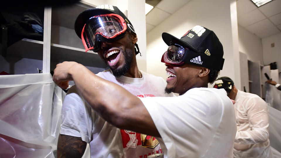 Leonard, left, and Lowry celebrate in the locker room. THE CANADIAN PRESS/Frank Gunn