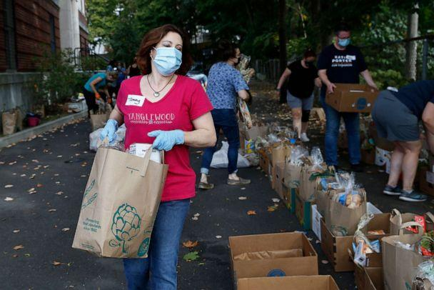 PHOTO: In this Sept. 27, 2020, file photo, Tammy Lynch volunteers at a pickup site for food distribution with the Roslindale Collective in Boston. (Jessica Rinaldi/The Boston Globe via Getty Images, FILE)