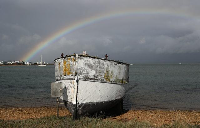 Rainbow over fishing boat in Hampshire