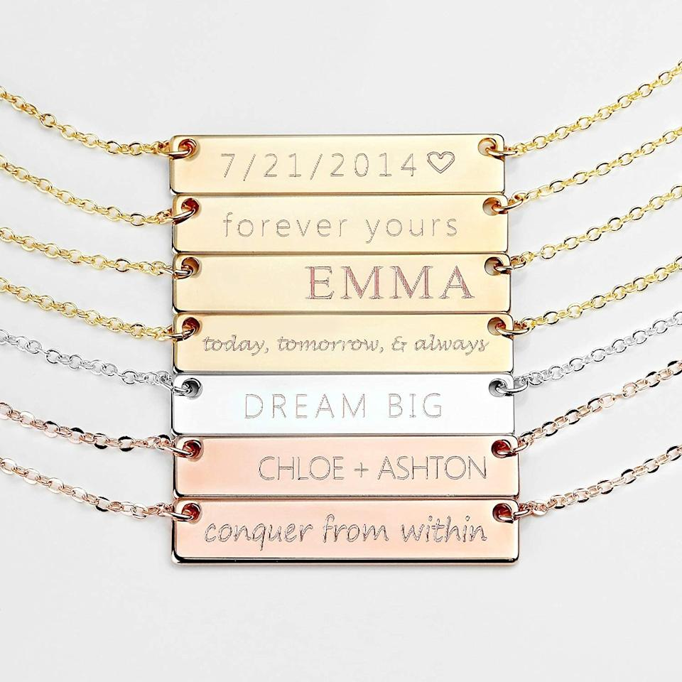 """<p>Customize this <a href=""""https://www.popsugar.com/buy/Personalized-Name-Plate-Necklace-398611?p_name=Personalized%20Name%20Plate%20Necklace&retailer=amazon.com&pid=398611&price=18&evar1=savvy%3Auk&evar9=45588360&evar98=https%3A%2F%2Fwww.popsugar.com%2Fsmart-living%2Fphoto-gallery%2F45588360%2Fimage%2F45589847%2FPersonalized-Name-Plate-Necklace&list1=shopping%2Cgifts%2Camazon%2Choliday%2Cchristmas%2Cgift%20guide&prop13=api&pdata=1"""" rel=""""nofollow"""" data-shoppable-link=""""1"""" target=""""_blank"""" class=""""ga-track"""" data-ga-category=""""Related"""" data-ga-label=""""https://www.amazon.com/dp/B015HVACEA/ref=cm_gf_aAN_i2_d_p0_qd0_______________________nj0fE3ZqrehOjAhmYHRJ"""" data-ga-action=""""In-Line Links"""">Personalized Name Plate Necklace</a> ($18).</p>"""