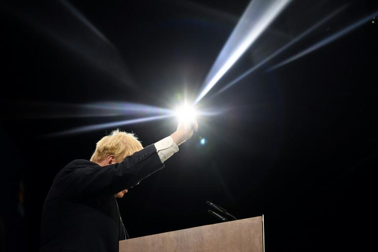 Johnson said Britain's current problems are unavoidable if the economy is to be reset after Covid and Brexit (AFP/Ben STANSALL)