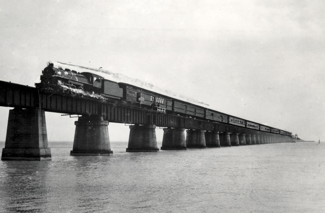 In this undated photograph courtesy of the Monroe County Library, the Henry Flagler's Florida Keys Over-Sea Railroad train on the Seven Mile Bridge is shown near Marathon, Fla. The centennial anniversary of the first train's arrival into Key West and the completion of the Over-Sea Railroad project will be marked on Jan. 22, 2012. (AP Photo/Monroe County Library via the Florida Keys News Bureau)