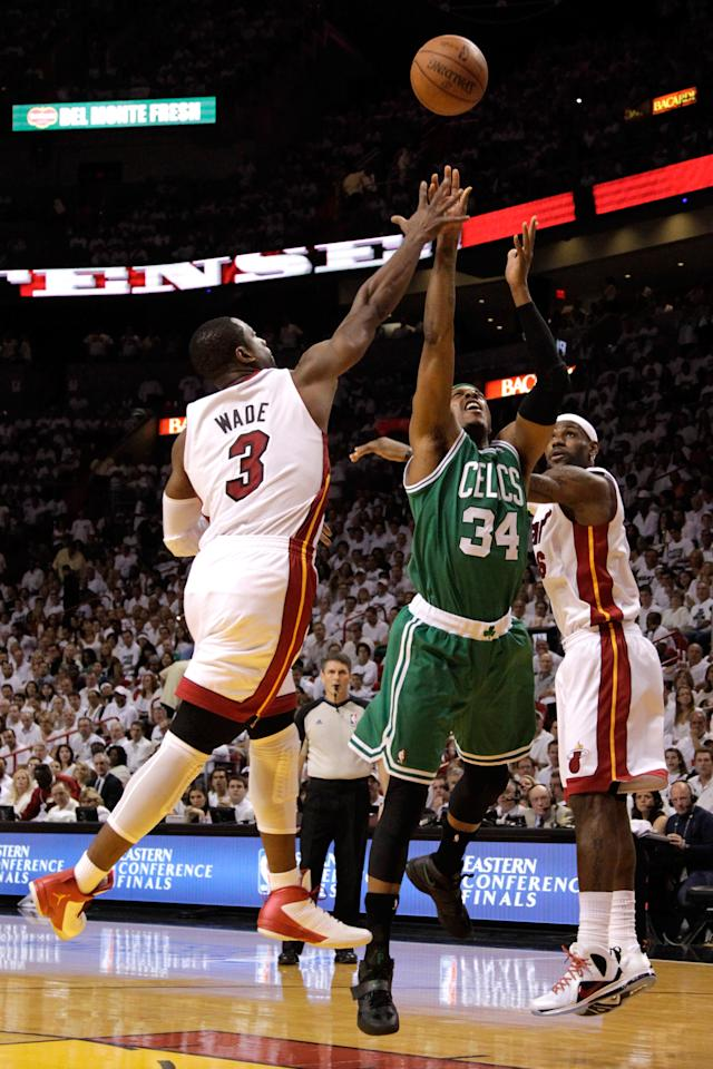 MIAMI, FL - JUNE 09:  Paul Pierce #34 of the Boston Celtics goes up for a shot between Dwyane Wade #3 and LeBron James #6 of the Miami Heat in the first quarter in Game Seven of the Eastern Conference Finals in the 2012 NBA Playoffs on June 9, 2012 at American Airlines Arena in Miami, Florida. NOTE TO USER: User expressly acknowledges and agrees that, by downloading and or using this photograph, User is consenting to the terms and conditions of the Getty Images License Agreement.  (Photo by Mike Ehrmann/Getty Images)