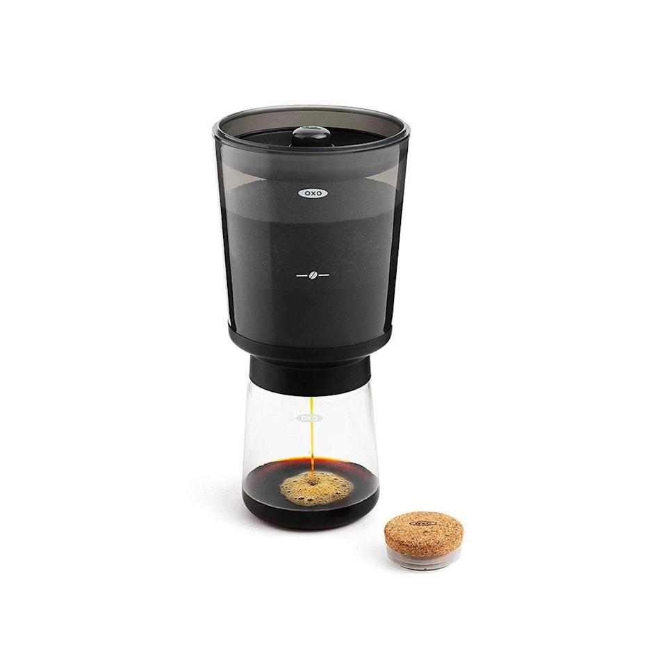 """They may miss their cold brew, but no one misses spending $5 on it every day on their way to work. This gift almost pays for itself after its first use, since the <a href=""""https://www.glamour.com/gallery/gifts-for-coffee-lovers?mbid=synd_yahoo_rss"""" rel=""""nofollow noopener"""" target=""""_blank"""" data-ylk=""""slk:Joe addict"""" class=""""link rapid-noclick-resp"""">Joe addict</a> on your list can make up to a week's worth in just 24 hours. $30, Amazon. <a href=""""https://www.amazon.com/OXO-Cold-Coffee-Maker-11237500/dp/B07HB3GH6W"""" rel=""""nofollow noopener"""" target=""""_blank"""" data-ylk=""""slk:Get it now!"""" class=""""link rapid-noclick-resp"""">Get it now!</a>"""