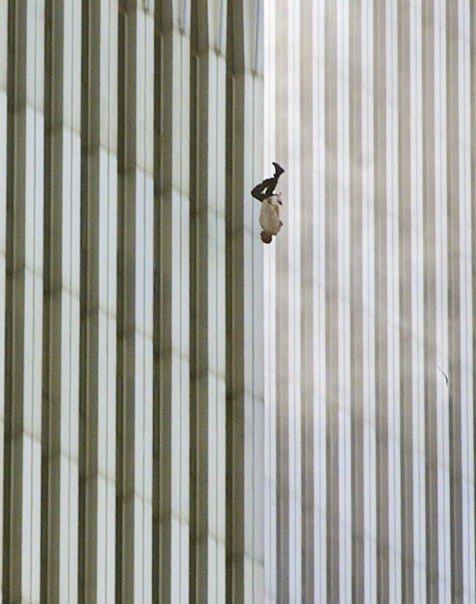 "In a scene repeated with terrifying frequency as flames engulfed the top of the towers, a man falls (or leaps, as was evidently the case with many victims) to his death from the World Trade Center. On the morning of September 11 photographer Richard Drew, in the midst of another assignment, got the call to drop everything and head to the World Trade Center. As soon as he arrived downtown he began shooting; later in the day, as as he processed what he had shot, he was especially struck by this photo -- and with reason. One of the most recognizable pictures made on 9/11, the image from a purely photographic perspective is breathtaking: the miniscule human form caught against the massive, abstract background of the towers is so obviously helpless, and doomed, that we're tempted to reach out our hands to try and cradle the tiny anonymous figure. And while Drew himself refuses to conjecture about the man's identity (""I prefer to think of him as a sort of Unknown Soldier,"" he told LIFE.com), it's impossible not to put ourselves in the falling man's place -- with all the dread and empathy that that sort of transference commands. <br><br>(Photo: AP Photo/Richard Drew)<a href=""http://www.life.com/gallery/59971/911-the-25-most-powerful-photos#index/0"" rel=""nofollow noopener"" target=""_blank"" data-ylk=""slk:"" class=""link rapid-noclick-resp""><br></a>"