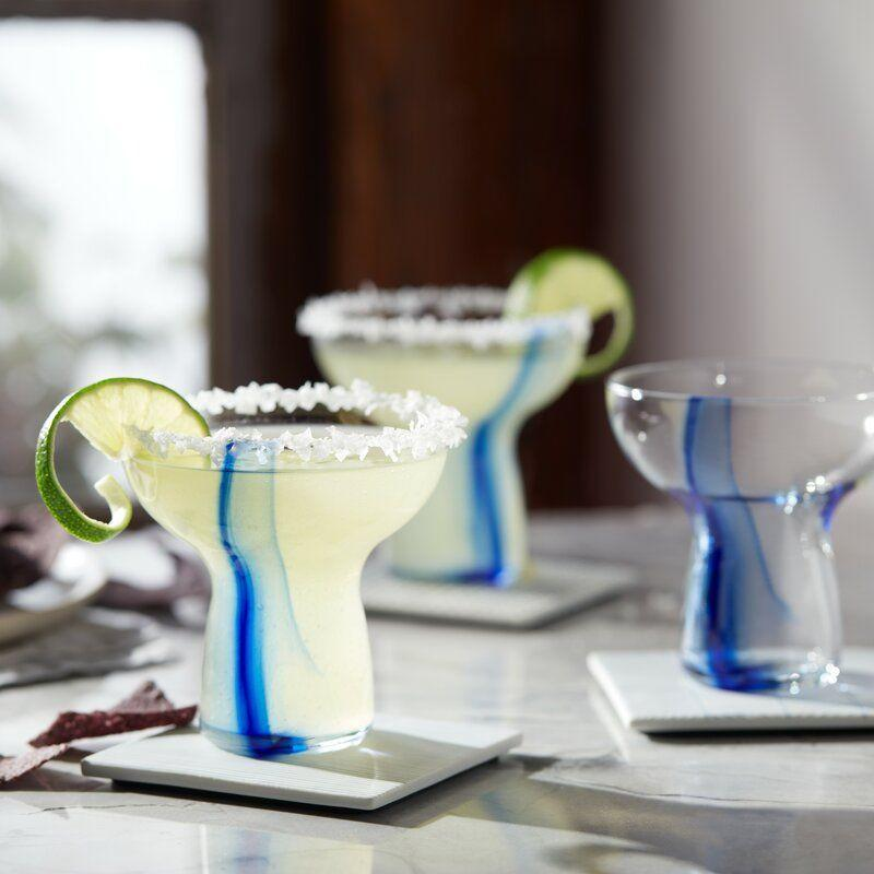 """<p><strong>Libbey</strong></p><p>wayfair.com</p><p><strong>$33.90</strong></p><p><a href=""""https://go.redirectingat.com?id=74968X1596630&url=https%3A%2F%2Fwww.wayfair.com%2Fkitchen-tabletop%2Fpdp%2Flibbey-ribbon-1025-oz-margarita-glass-kbjs1103.html&sref=https%3A%2F%2Fwww.delish.com%2Ffood-news%2Fg35916453%2Fbest-margarita-glasses-and-sets%2F"""" rel=""""nofollow noopener"""" target=""""_blank"""" data-ylk=""""slk:BUY NOW"""" class=""""link rapid-noclick-resp"""">BUY NOW</a></p><p>Another twist on the classic, these ones are especially great for holding while standing around at parties as they come complete with their own natural grips.</p>"""