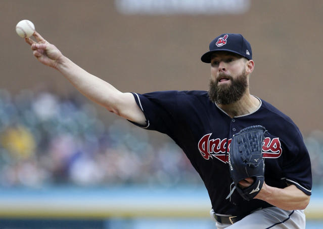 FILE - In this June 10, 2018, file photo, Cleveland Indians' Corey Kluber pitches against the Detroit Tigers during the second inning of a baseball game in Detroit. Kluber, Gerrit Cole and Clayton Kershaw are among the many big league pitchers maximizing success by throwing fewer fastballs. (AP Photo/Duane Burleson, File)
