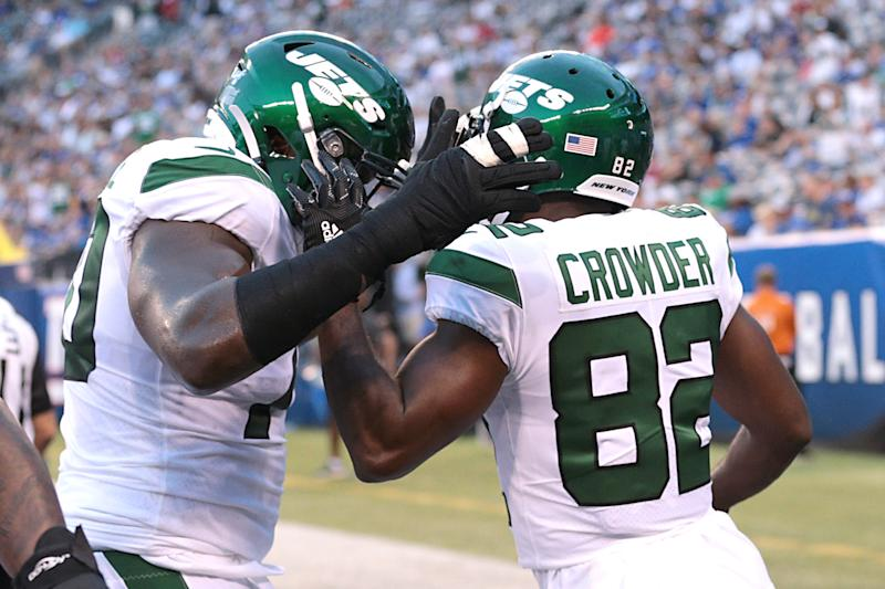 Aug 8, 2019; East Rutherford, NJ, USA; New York Jets wide receiver Jamison Crowder (82) celebrates after a touchdown reception with offensive guard Kelechi Osemele (70) during the first half against the New York Giants at MetLife Stadium. Mandatory Credit: Vincent Carchietta-USA TODAY Sports