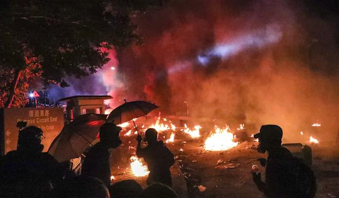 Clashes break out between protesters and riot police at Chinese University. Photo: Felix Wong