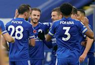 Leicester celebrate Jamie Vardy's goal against Wolves from the penalty spot