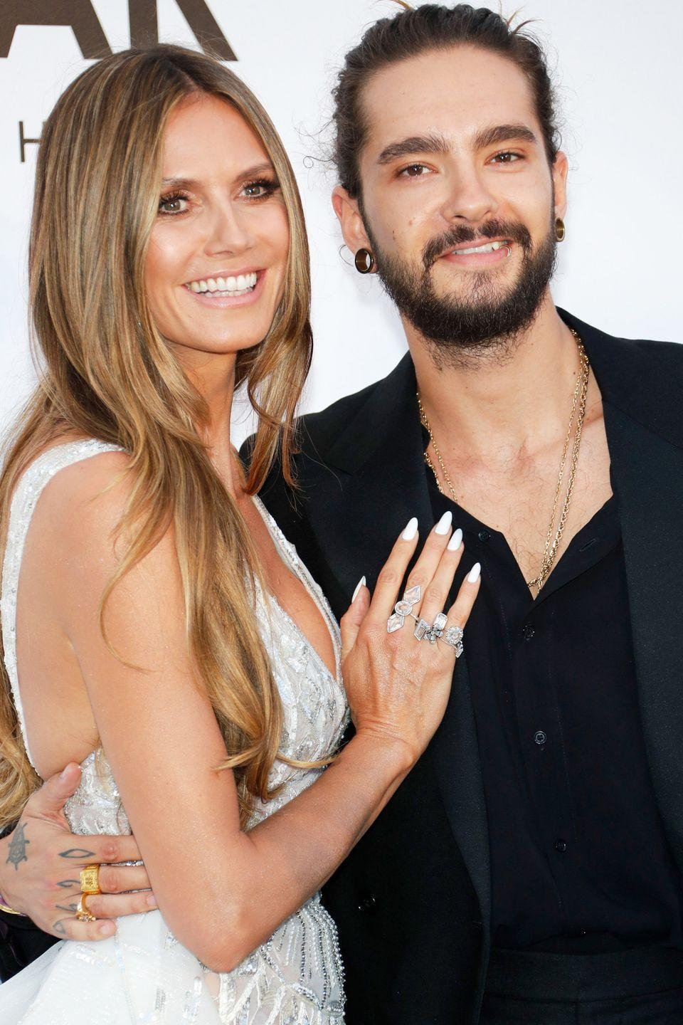 """<p><strong>Age gap: </strong>17 years</p><p>Heidi might have revealed her best anti-aging secret when she explained her thoughts on her and husband Tom Kaulitz's 17-year age gap. """"You have to just live a happy life without worrying too much about what people think because worrying is only going to give you more wrinkles,"""" Heidi told <a href=""""https://www.instyle.com/news/heidi-klum-downside-dating-someone-17-years-younger"""" rel=""""nofollow noopener"""" target=""""_blank"""" data-ylk=""""slk:InStyle"""" class=""""link rapid-noclick-resp""""><em>InStyle</em></a>. The pair started dating in 2018, got engaged later that year, and made it official this summer.</p>"""