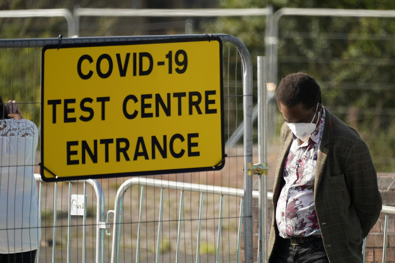 BOLTON, ENGLAND - SEPTEMBER 17: People queue at a walk in Covid-19 testing centre on September 17, 2020 in Bolton, England. Fears about rising infection rates among younger people across the Uk has forced the government into tighter lockdown restrictions, particularly in the North of England. (Photo by Christopher Furlong/Getty Images)