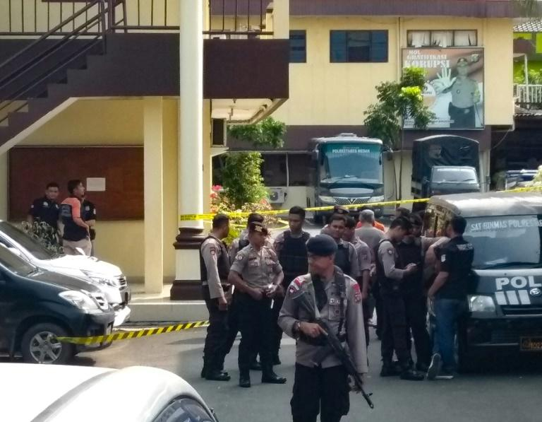Indonesian police at their headquarters in Medan after the suspected suicide attack