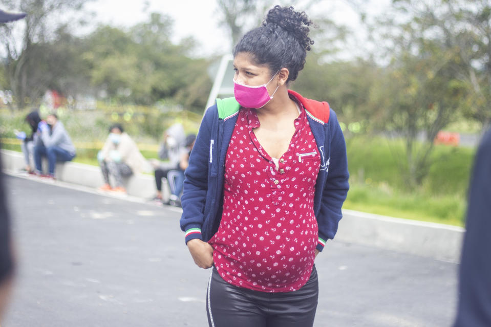 A pregnant woman waiting for the Colombian authorities to give the authorization to return to her country.  Hundreds of Venezuelan migrants saved to pay for the bus trip that would take them back to their country. However, today they are detained by the authorities at the Los Andes toll located on the North highway in Bogota, Colombia, on April 29, 2020. (Photo by Daniel Garzon Herazo/NurPhoto via Getty Images)