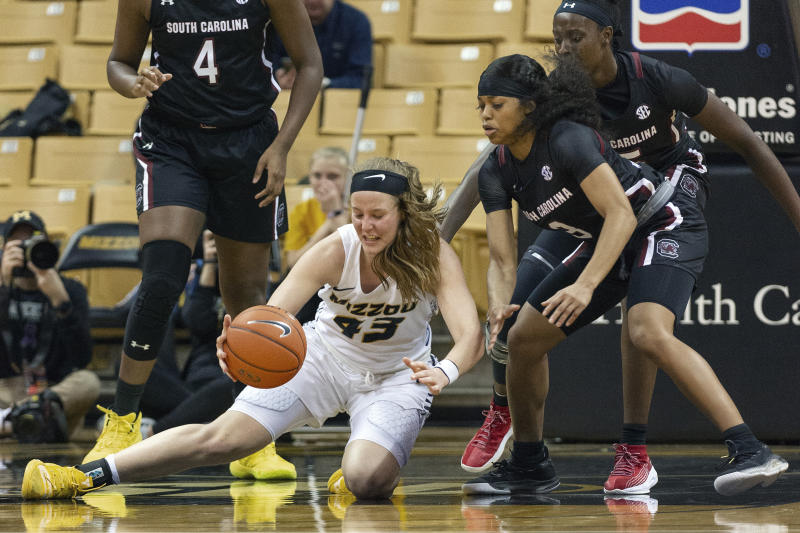 Missouri's Hayley Frank, left, picks up a loose ball in front of South Carolina's Destanni Henderson, right, during the first half of an NCAA college basketball game Thursday, Jan. 16, 2020, in Columbia, Mo. (AP Photo/L.G. Patterson)