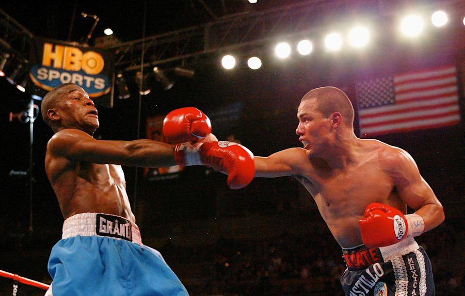 Floyd Mayweather's unanimous decision over Jose Luis Castillo during their 2002 WBC Lightweight Title fight was one of the great fights broadcast on HBO. (Photo by Donald Miralle/Getty Images)
