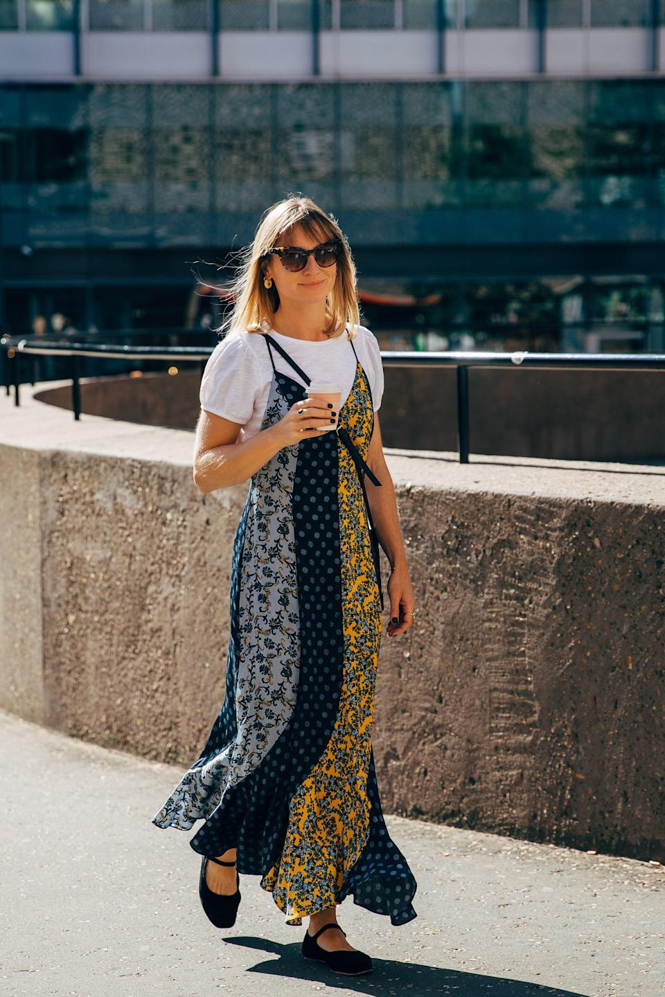 <p>Layer a brightly printed slip dress over a white tee. </p>
