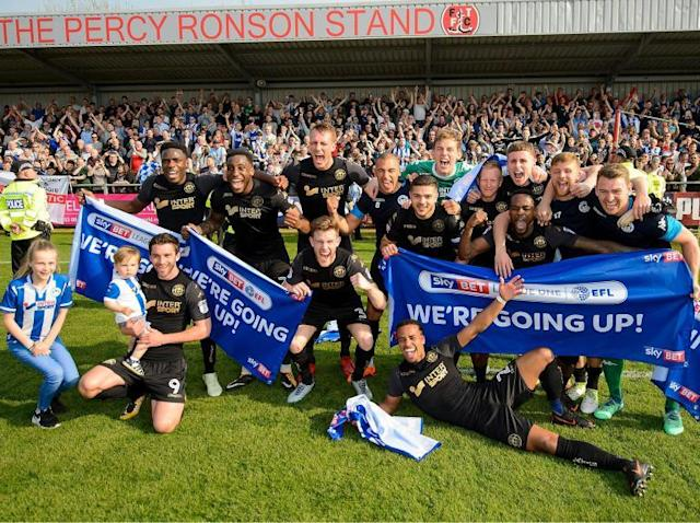 Wigan Athletic seal promotion to Championship as next Fleetwood manager Joey Barton watches on