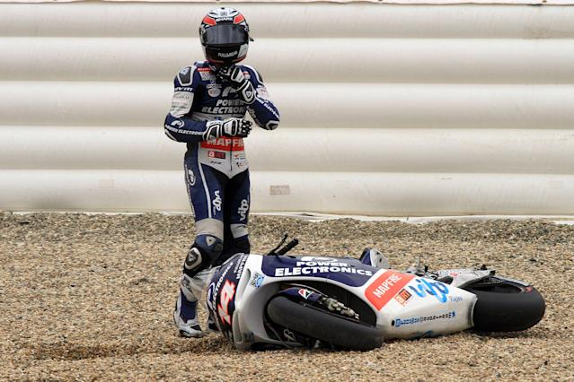 France's Randy de Puniet stands near his motorbike after crashing during the qualifying pratice session of the Czech Republic Grand Prix in Moto GP on August 25, 2012 in Brno ahead of the Grand prix on August 26. AFP PHOTO/RADEK MICARADEK MICA/AFP/GettyImages