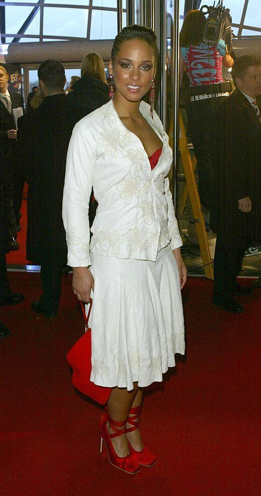<p>The singer wore a white skirt suit with lace applique, which she co-ordinated with red accessories, including a bag, earrings, shoes and bralette!</p>